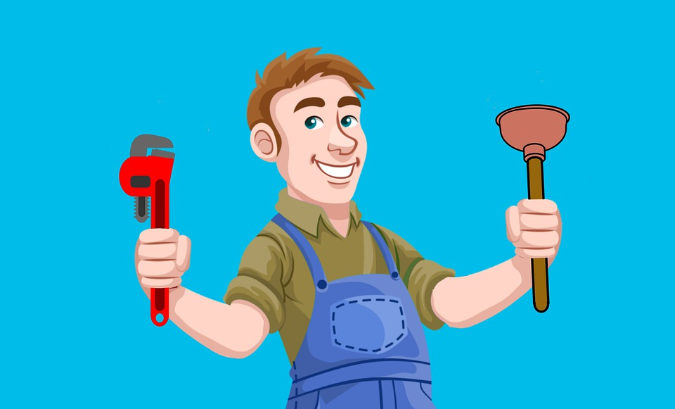 plumber holding his tools