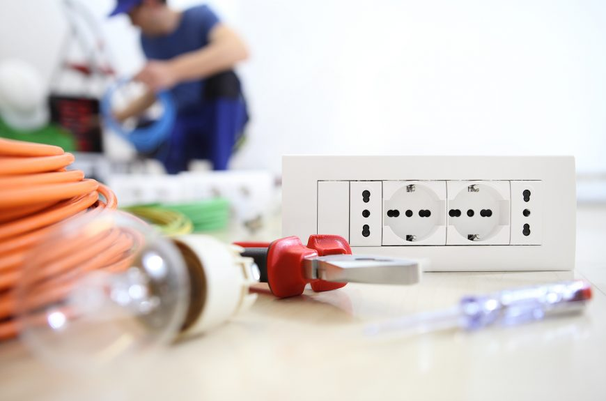 electrician work with electrical equipment in the foreground