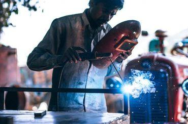 a worker using a laser cutting machine