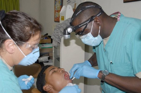Two dentists performing wisdom teeth removal in Hawkesbury