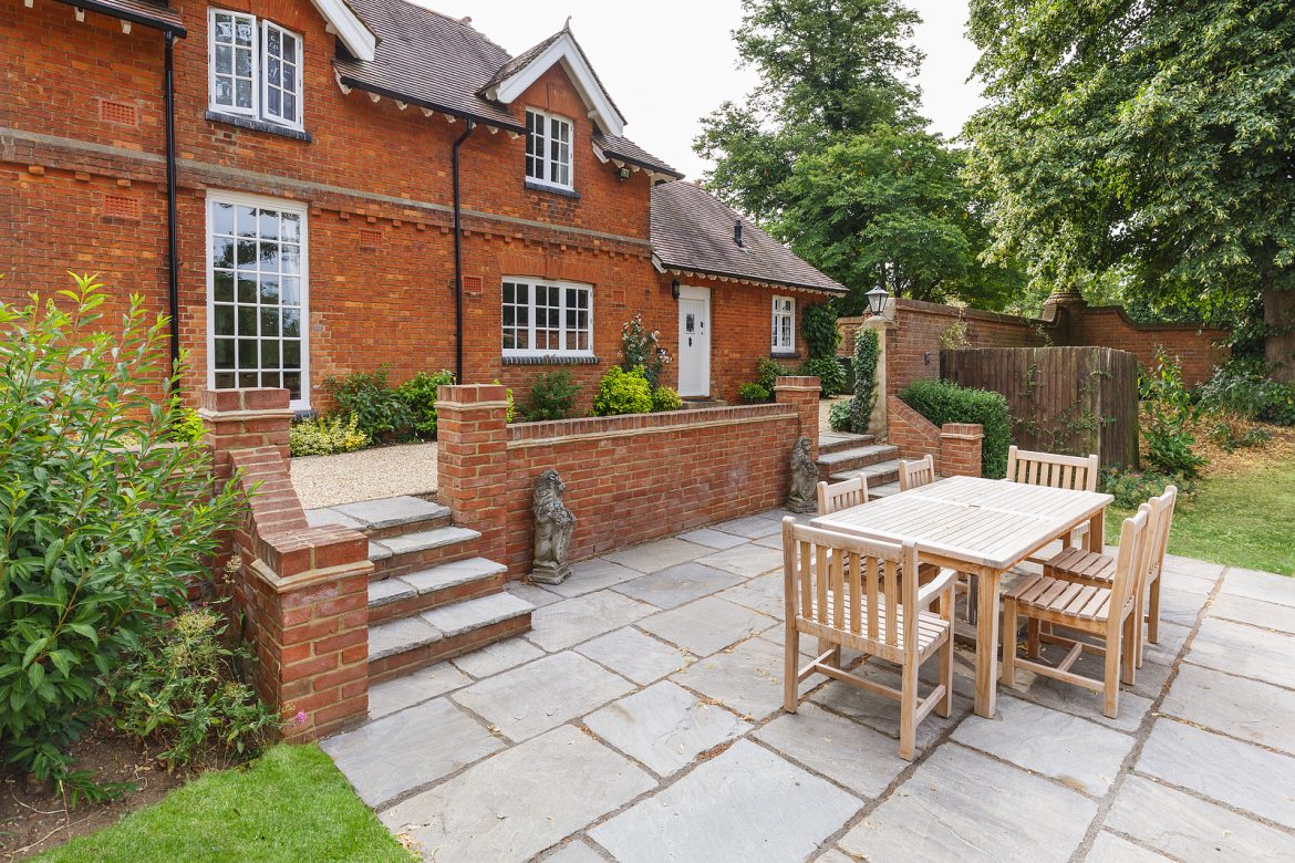 Large house with teak outdoor furniture in the garden